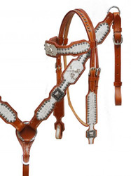 Showman ® Embossed leather headstall and breast collar set with crossed guns conchos.