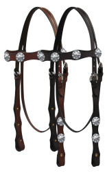 Double stitched leather headstall with engraved silver conchos on browband and cheeks.