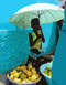 """Cape Verde  This colorful Cape Verde market scene features an abstracted photo of a young fruit vendor in Porto Novo proudly displaying her wares.   Cards measure 5-1/2"""" by 4-1/4""""; blank inside.  Set includes 8 cards and envelopes for $8.00.      NEW!  Photo © 2008 John Earle (with Photoshop enhancement)"""