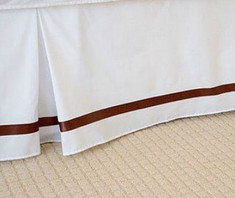 Custom made Linen bed skirt, trimmed with ribbon.