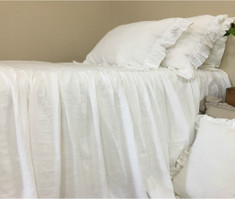 White ruffled bed cover