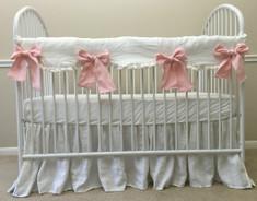white bumperless crib bedding, pink ties,