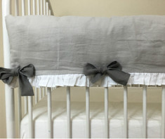 Stone grey rail cover with white ruffle hem with medium grey bows