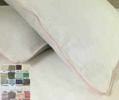 White linen duvet cover with piping
