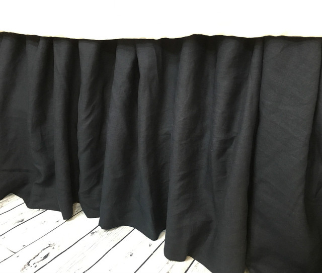 Complement your bedding décor with this black linen bed skirt