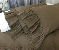 dark brown pillow case with long ruffles