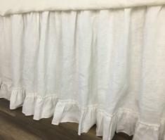 white bed skirt with ruffle hem