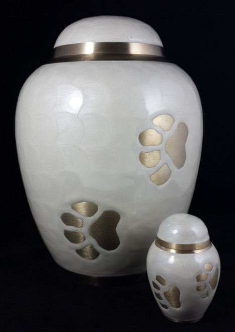 "The 3"" keepsake urn put next to the 8"" urn to give you a perspective of the size."