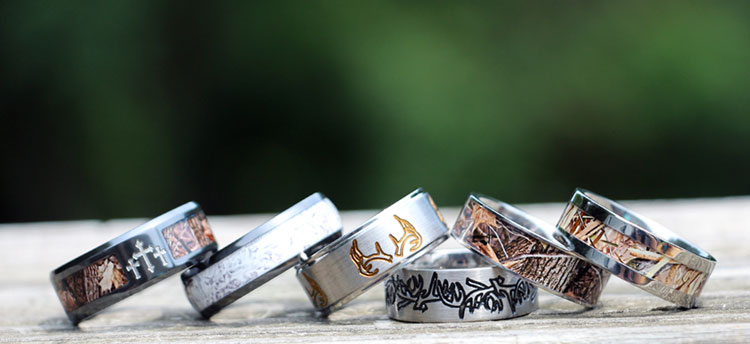 Camo Wedding Rings > The hunt is over y'all