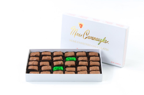 Mindy Mint Truffle Try our most popular chocolate yet? Order the Mindy Mint Truffles today. Our melt in your mouth Mindy Mint Truffles are made with premium chocolate and our own custom peppermint oil for a taste that keeps you coming back again and again. Mrs. Cavanaugh's Mindy Mint assorted box is available in milk chocolate, dark chocolate, or a mix of the two chocolates in 1lb. 2 lb. 3 lb. & 5 lb. boxes.