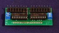 Top side of CSNK showing ULN2803 darlington drivers, 0.156 Molex connectors and screw terminals for the external supply for the clamping diodes.  Note that each 8 channel ULN2803 has its own connector, so you can group all of the (say) 24V devices on chip and all of the 12V devices on the other.  If the loads are purely resistive, or if external protection is provided, you don't need to use the internal clamps and load supply voltages may be mixed freely.