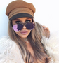 Designed by Kylie Jenner for Quay Australia.  Elevate yourself to ICONIC status with these glamorous, sportswear-inspired aviators. These sunnies feature oversized metal aviator frames with a mesh accent at the bridge and flat reflective lenses.  Includes a new premium case with luxury gold hardware & keychain loop.