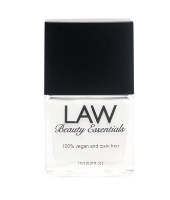 LAW all vegan toxin free nail polish as seen in IPSY's glam bags and celebrity glam bags! Color shown is HASHTAG WHITE! This snow white color is perfect for whether your trying to achieve a Pearly, high gloss full nail or a simple, elegant white tip. With just two coats and a gloss finish Hashtag White is a preferred tailored polish to have for any occasion.