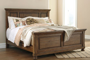 Flynnter Medium Brown Queen Sleigh Storage Bed