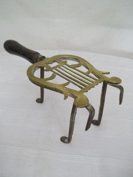 A GOOD SIZED ANTIQUE BRASS AND IRON FIRESIDE TRIVET