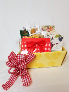The perfect gift for your favorite Cook whether she or he loves to cook - or not.  Either way your recipient will love the contents.  This gift box contains a magnetic notepad perfect for keeping it handy, and it comes with a mini spatula, too.  Then we add a recipe holder and a small paring knife, cocktail napkins, and a Popcorn Cob, perfect for a big bowl of fresh popcorn!  A Spice rack guide, along with a wonderful bag of seasonal pasta and a delicious Marinara Sauce Mix, too.  Last but not least, a small hand sannitizer is included to keep those hands and fingers nice and fresh.