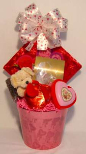 A small Valentine Basket with a Big Heart.  Along with a small Valentine plush we add small chocolate Valentine hearts.  A simple gesture with lots of love.