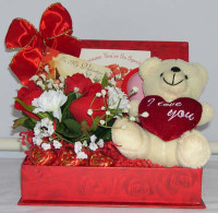 Treat your Valentine to this delightful combination of chocolates, a huggable  plush, and a Valentine card to express your sentiments.  And this special gift comes  all wrapped up in a keepsake rose photo box.