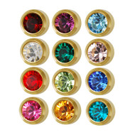 Assortment of Studex piercing studs with inset birthstones