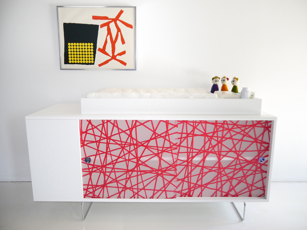 Alto Credenza shown with Red Strand panels and optional changing tray.