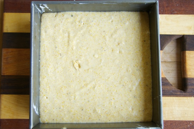 cornbread batter in a square baking pan