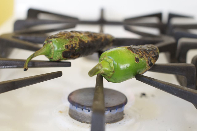 charred jalapenos on gas stove top