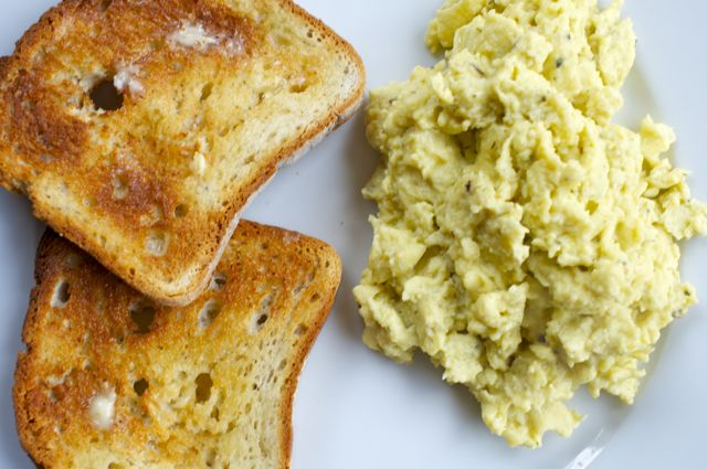 fluffy scrambled eggs with all natural french seasonings and toast bread