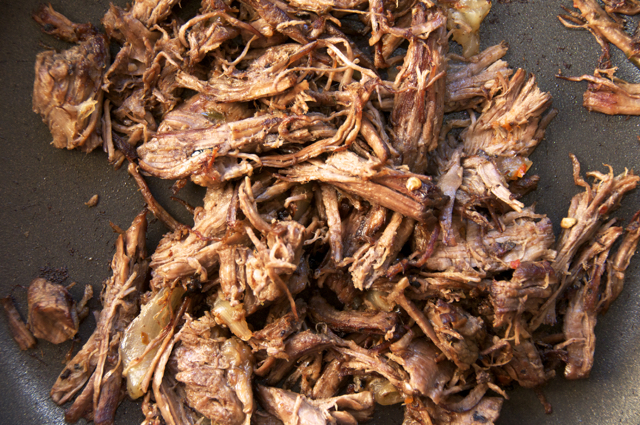 shredded beef in hot pan