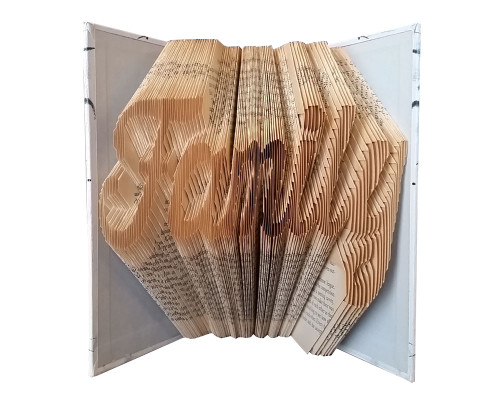 "A folded book that reads ""Family"""