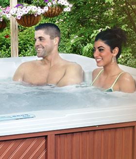 Majestic Series Spas couple relax in hot tub.
