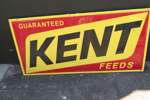 SUPERB VINTAGE KENT FEEDS EMBOSSED PRESSED METAL LARGE ADVERTISING SIGN.