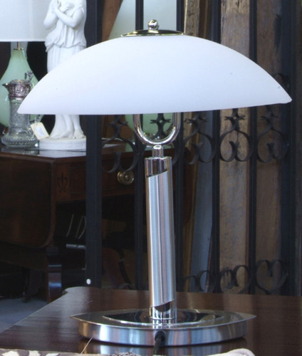 Modern Deco inspired Nickel lamp with a frosted glass oval shade. 39cm high. Popular as bedside lamps.