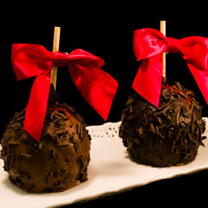 Limited Edition Black Raspberry Truffle Caramel Apple from DeBrito Chocolate Factory