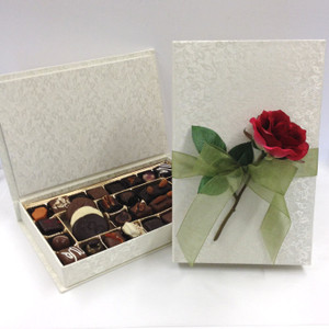Elegantly boxes chocolates for Valentine's Day filled with truffles, fruits, nuts, chews, creams, and more.