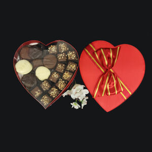 A heart-shaped box filled with milk chocolate buttery almond toffee and decadent chocolate-covered apricots is a classic Valentine's gift for the one you love.
