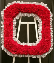 """This custom made Ohio State """"O"""" can be created to honor your Buckeye fan.  The red carnations are trimmed in a light gray ribbon and attached to a wooden easel for easy display."""