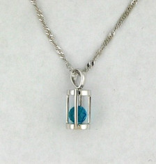 Blue Topaz and Diamond Cage Pendant. 18 KW Gold. .10 CTTW. Spherical Cut Topaz Sits Freely in White Gold Cage.