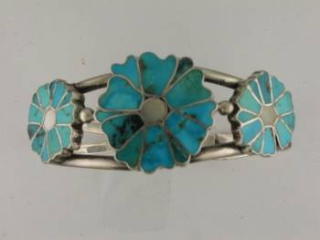 A one of a kind custom design gem from Mary Beth's workshop... three flowers created from individual turquoise petals set on a heavy sterling silver bracelet.