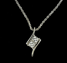 Two-Stone created moissanite pendant in 14K white gold. The gemstones are near-colorless, 4mm square, a creation of Charles and Colvard's Forever Brilliant line of jewelry.  Moissanite is a created gemstone that that has dispersion 2.4 times higher than diamond, a greater refractive index than diamond, and double refraction on the upper pavilion facets for astonishing fire.  The gemstones are harder than rubies, and almost as hard as diamonds. Chain is not included.
