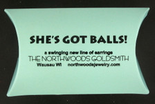 """Our balls are delivered in this box, with the inscription """"a swinging new line of earrings."""""""
