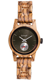 Tense handcrafted zebrawood Small Hampton lady's watch, proudly made in British Columbia. The watch is made from 100% recycled and reclaimed wood, with stainless steel crown and clasp. All Tense Watch pieces are hypoallergenic, adjustable in size and manufactured in Canada with Miyota Watch Movements from Japan. Watch comes with a beautiful wooden case, a polishing cloth, and a tool for removing links.