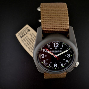 This Bertucci DX3 Field Watch features unmatched performance and value. With classic Bertucci styling and a rugged design, this affordable sports watch's poly resin and fiber body is artistically sculpted and water resistant to 50 meters.  Beautifully designed in the heart of Chicago, every Bertucci watch is perfect for any occasion whether it be a hunting trip in the Northwoods or an elegant dinner engagement. The interchangeable bands slip into the watch body without attachment pins. Water resistant to 50 meters. Made in the USA. Three-year warranty.  Black dial, coyote nylon band.