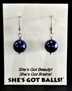 "Each pair of dark blue balls consists of high quality created Swarovski pearls on French wires, accompanied by our delightfully tacky packaging. Our balls come mounted on this card, with the inscription ""She's Got Beauty! She's Got Brains! She's Got Balls!"""