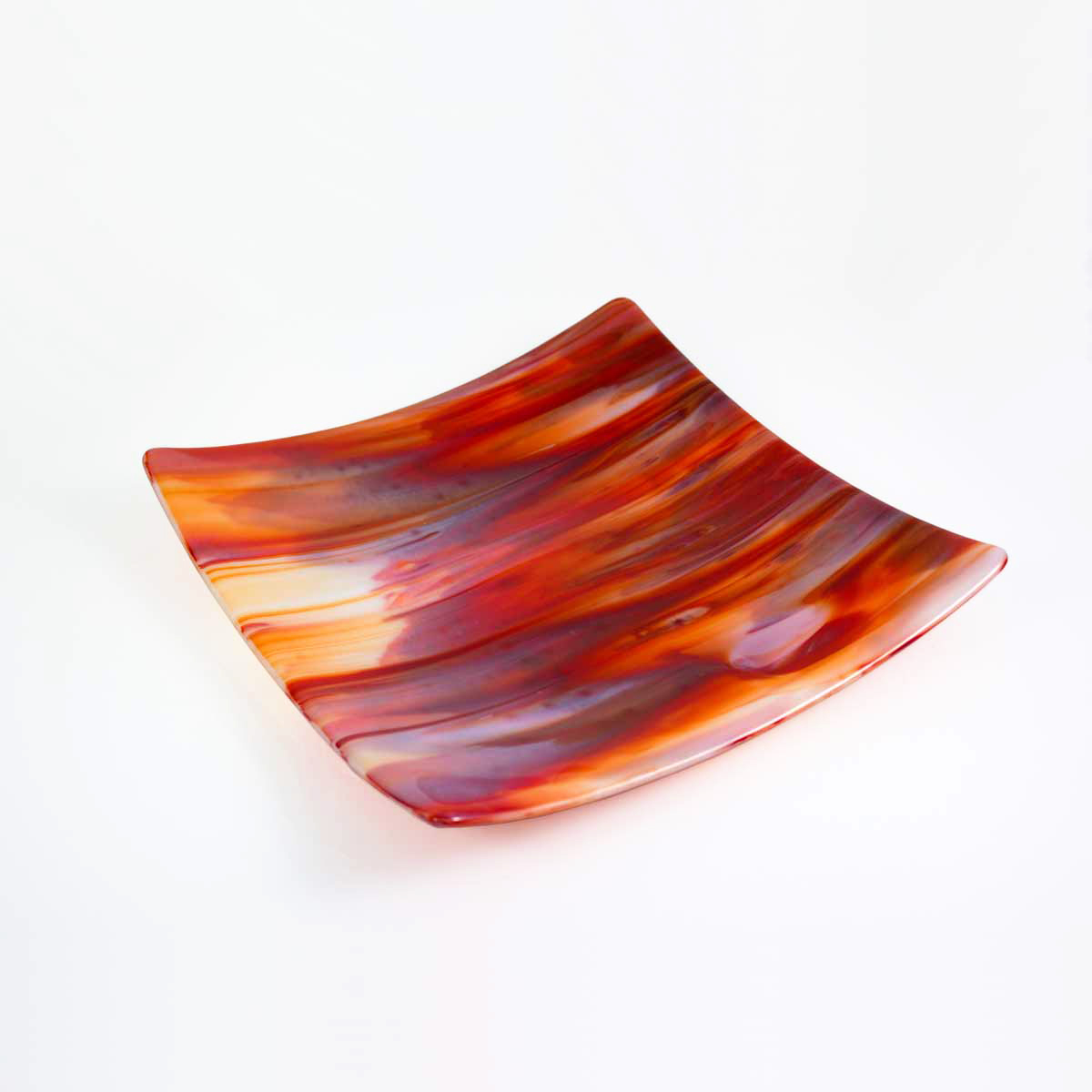 A Kiln-formed glass platter in reds and oranges. 30cm square with raised corners (3cm) to create a beautiful movement. Stunning!!