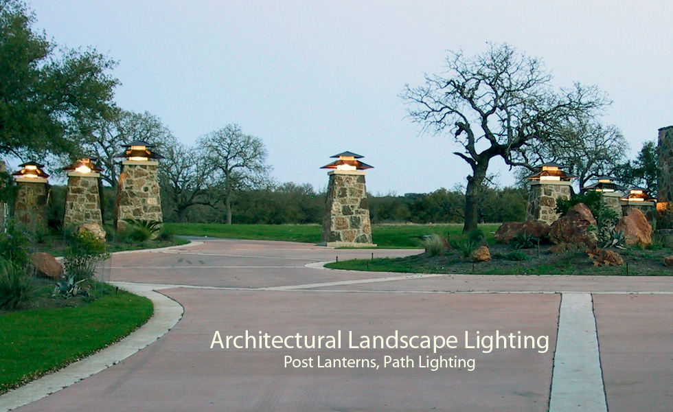 Large post lanterns at an entrance to a subdivision.