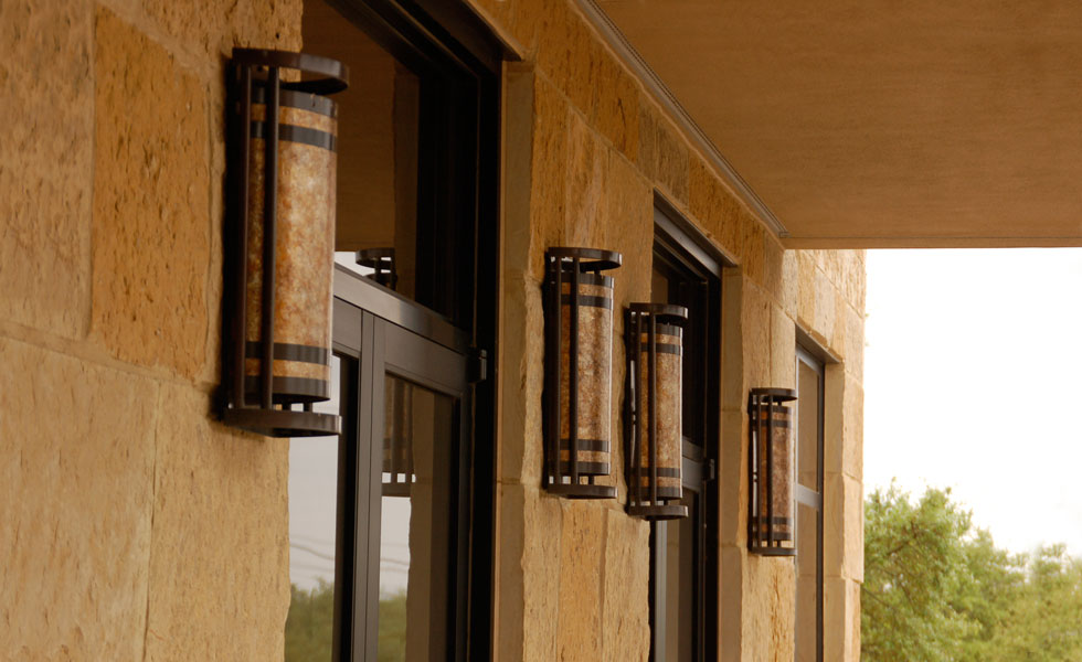Custom mica and copper tall wall sconces.