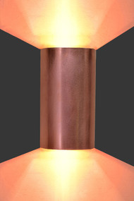 "Copper half cylinder wall light with up and down lighting.  This is an image of a sconce 5.5"" wide x 11"" tall.  A taller sconce will create a narrower light dispersion."