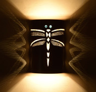 This handsome dragon fly wall sconce made from hand burned copper and Nomex provides an interesting display of light on your wall which greatly adds beauty to this functional piece of art.