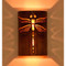 Dragon Fly Wall Sconce shown in burnt copper and amber mica.  This is a warm toned inviting look in a light fixture.