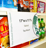 "Clear sign sleeve clips into shelf channel to display large tabloid sized graphics 17""w x 11""h ."